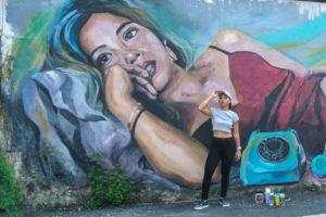 Artist, Mandy Maung with her artwork