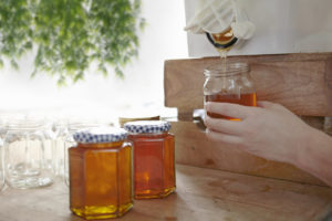 Pouring honey into jars